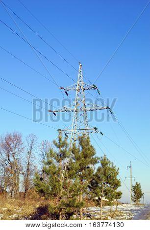 High voltage electrical power line transmission pylon (winter view)