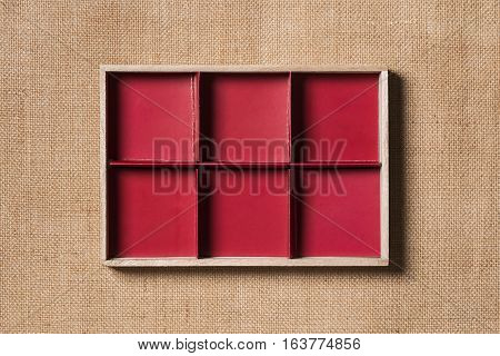 Burlap Frame Red Wooden Border over Sack Cloth Background Wood Frames on Fabric Texture