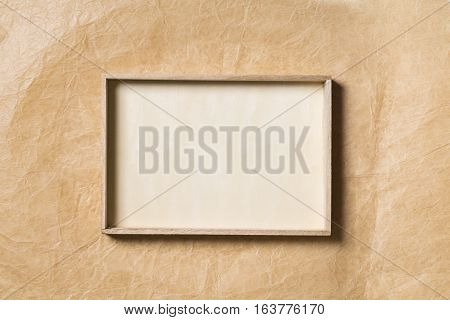 Wooden Frame over Paper Background Empty Wood Border for Picture on Brown Papers Texture