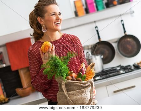 Laughing Woman In Profile, Fall Fruit And Vegetables In Kitchen