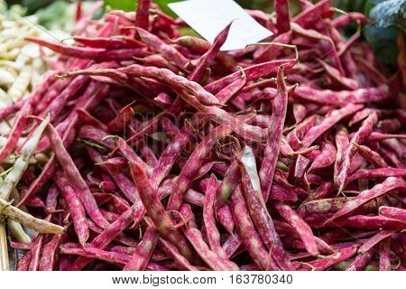 Pods of red beans on the counter farm market