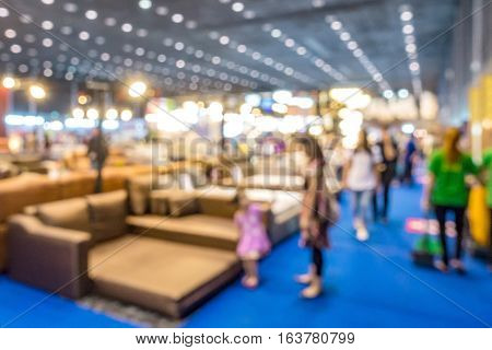 Abstract people walking in exhibition blurred defocusing background Concept of business social gathering for meeting exchange.