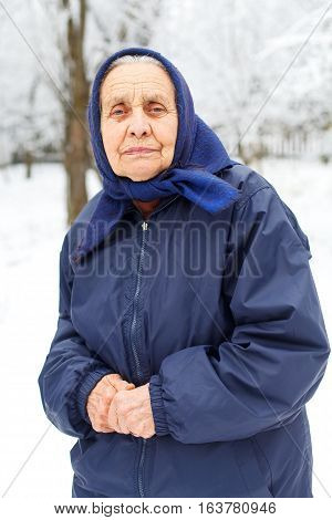 Portrait of an old retired woman on wintertime