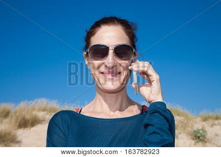Portrait Blue Sweater Woman With Sunglasses Talking On Mobile