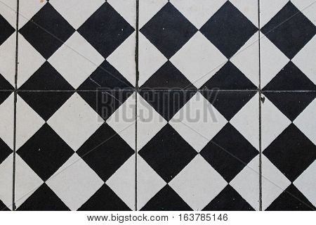 Background: black and white faience, vertical lines