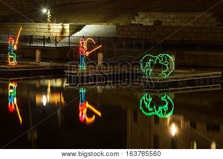 View of fisherman Christmas Display in the Ozarks of Missouri on a lake.