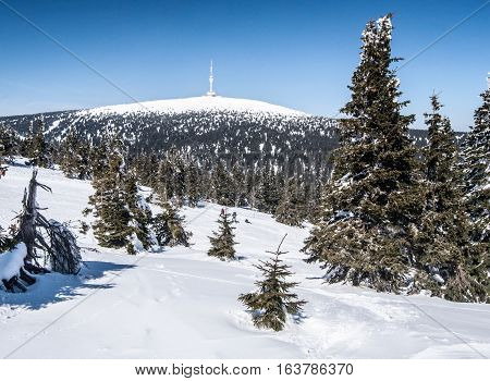 Praded hill in winter Jeseniky mountains with clear sky
