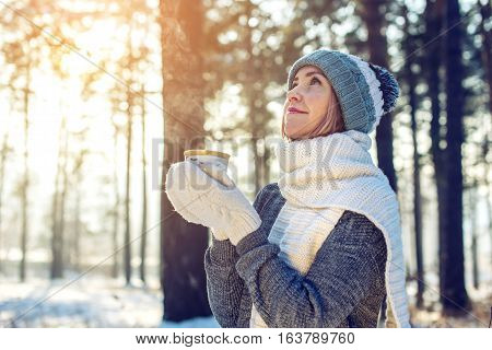 Attractive Woman In Winter Drinking Hot Tea On Sunlight