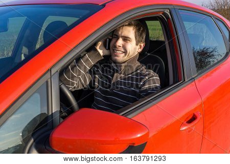 Man Is Driving A Car, Holds Telephone And Calling With Someone.