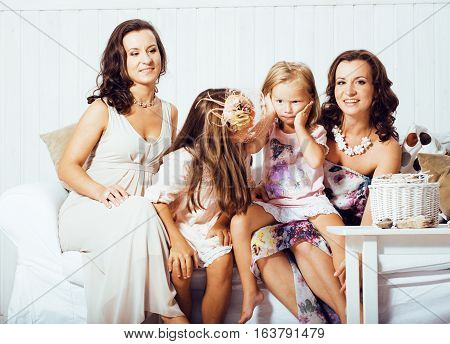 Mature sisters twins at home with little daughter, happy family in interior, lifestyle people concept close up