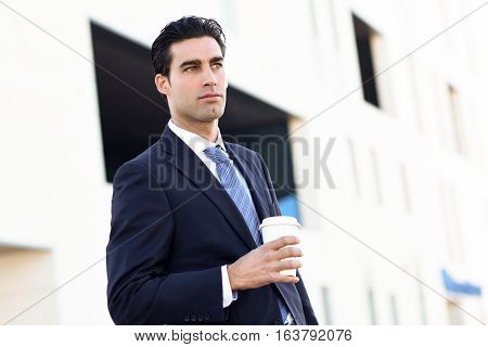 Businessman Drinking Coffee To Go With A Take Away Cup