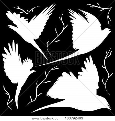 bird silhouettes cut-out. Decorations different poses and forms a pair of birds in the air over the branches for coloring