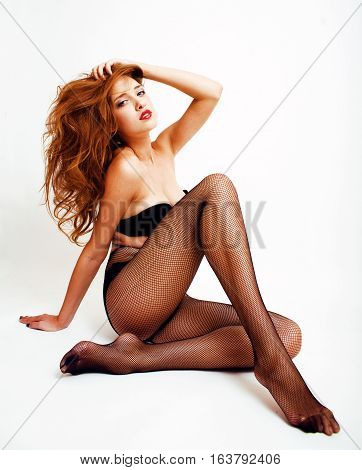 Sexy young real fashion woman in black pantyhose and lingerie, red lips, sexy look isolated on white background, seduction concept