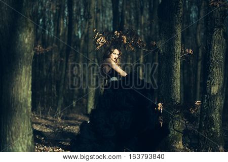 Elegant Young Woman In Forest