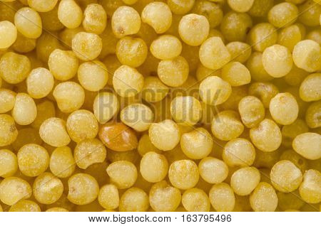 Uncooked raw millet. Food background. Healthy lifestyle concept. Closeup macro shot.