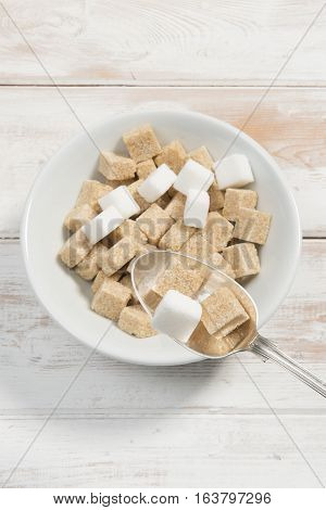 Pile Of Sugar Cubes On A Cereal Spoon