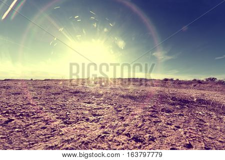 Outdoor soil floor background and sun in vintage style.