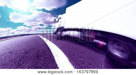 Truck transport and corporate logistics. Lorry delivering freight by road or highway