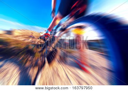 Extreme sport.Bicycle and speed concept. Wheel detail.Sport and healthy life.Mountain bike and landscape background