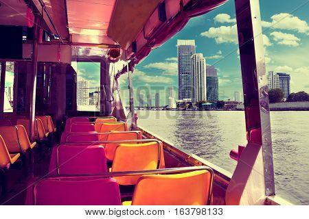 Bangkok city.Chao praya river and boat.Skyscraper.Exotic travels and adventures .Thailand trip.Buddha and landmarks