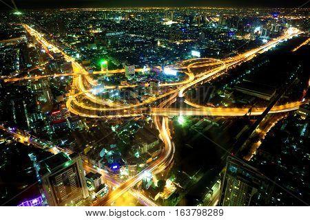 Bangkok at night.Cityscape and highwayroadbuildings and traffic.Bangkok city at night.Traffic and road scenery