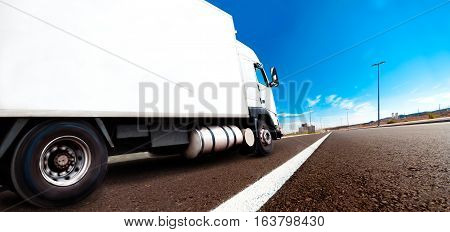 Truck and transport. Lorry delivering freight by road or highway