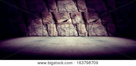 Cement floor and rock wall background and spotlight.