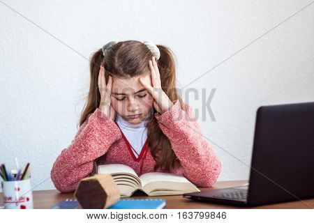Beautiful Cute Little Blond Girl With Glasses And Purple Dress Reading Big Book And Worried