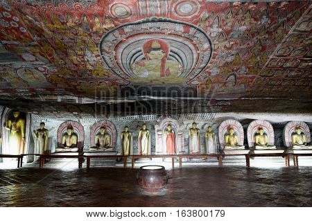 Inside of caves in ancient Buddhist complex in Dambulla cave temple. Sri Lanka. The photograph is presenting the statue of Buddha