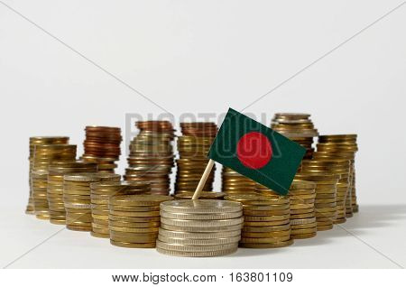 Bangladesh Flag Waving With Stack Of Money Coins