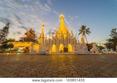 Sunset scence of White pagoda at Temple Wat Phra That Doi Kong Mu at Mae Hong Son near Chiang Mai Thailand