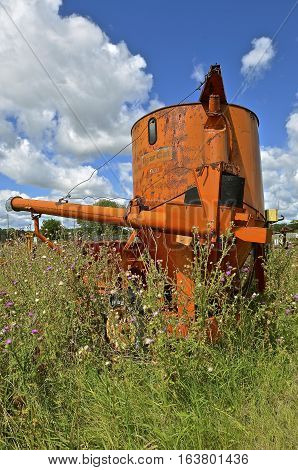 DETROIT LAKES, MINNESOTA, August 4, 2016. The  abandoned old Bear Cat Bearcat Grain King Grinder Mixers was manufactured by Western Land Roller Company, Hastings Nebraska in the early 1960's.