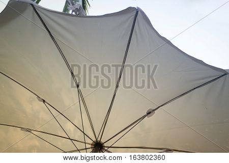 White umbrella in the garden stock photo