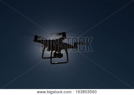 Copter against backlight. Copter against backlight. It is flying high in the sky