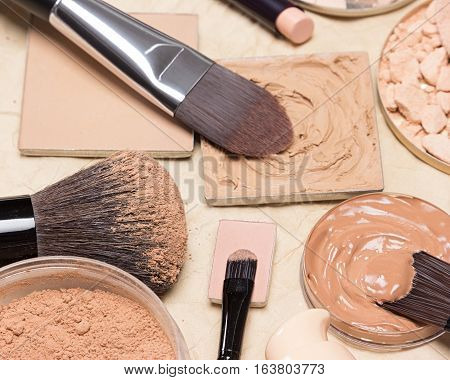 Foundation makeup products on crumpled paper, selective focus