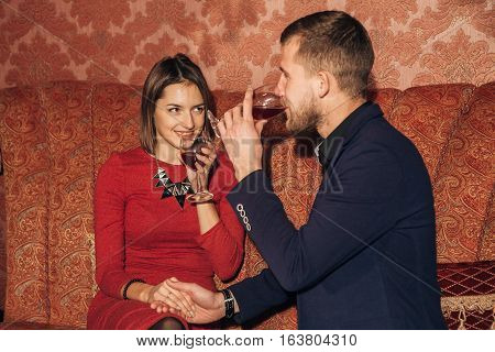 young couple flirting in the restaurant on a date, first date, love