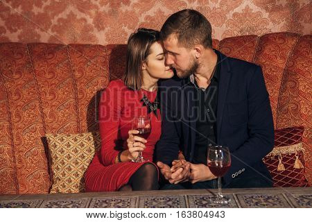 young couple flirting in the restaurant on a date.first date, love