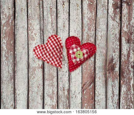 hand made textile hearts. Textile handicraft isolated on wooden background. Valentines Day Wedding composition with hearts.