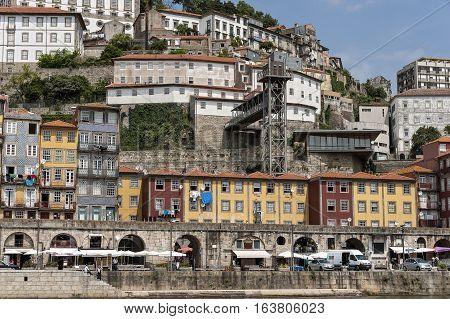Portugal Porto the embankment of Duora river residential quarters of the old town on the balconies drying clothes . The fortress wall .