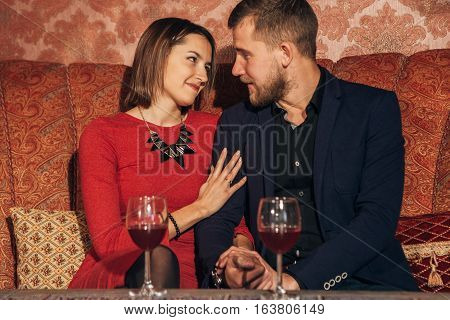 young couple flirting in the restaurant on a date. love