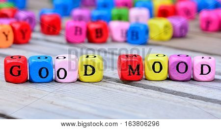 Good Mood words on grey wooden table