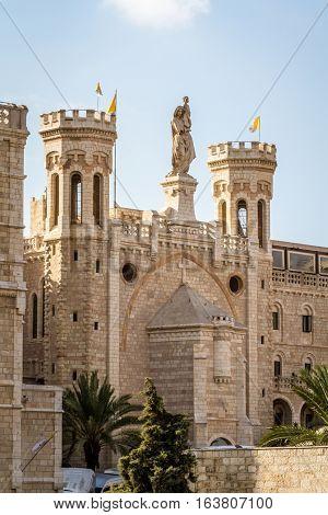 JERUSALEM ISRAEL - DECEMBER 8: Facade of Notre Dame de Jerusalem Notre Dame de France - Catholic monastery and guesthouse in Jerusalem Israel on December 8 2016