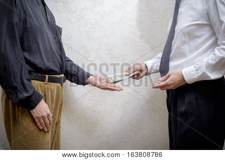 Man Paying  A Dollars Bribe To A Corupted Nan Accepting It