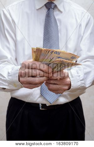 Businessman, Or Politician, Counting A Hryvnia Banknotes Bribe For Corruption