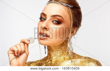 Girl with make-up. Girl with expensive jewelry