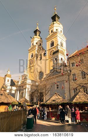 Brixen Italy - December 26 2016: Traditional Christmas market in Duomo Square with scenic view of the Cathedral.