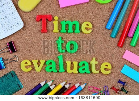 Time to evaluate word on cork background