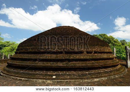 Polonnaruwa ruin was the second capital of Sri Lanka after the destruction of Polonnaruwa. The photograph is presenting Crematory Stupa at Alahana Parivena. Sri Lanka