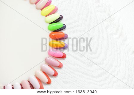 Colorful nails with nail varnish color sample plate