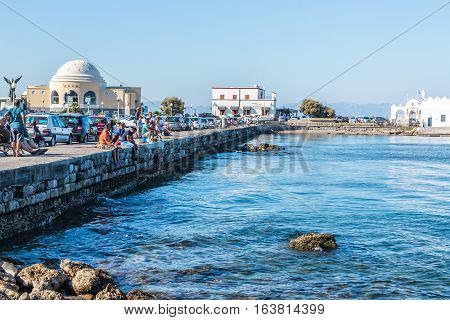 RHODES, GREECE-SEPTEMBER 23, 2016: Beautiful historical Mandraki Harbor of Island of Rhodes, Greece